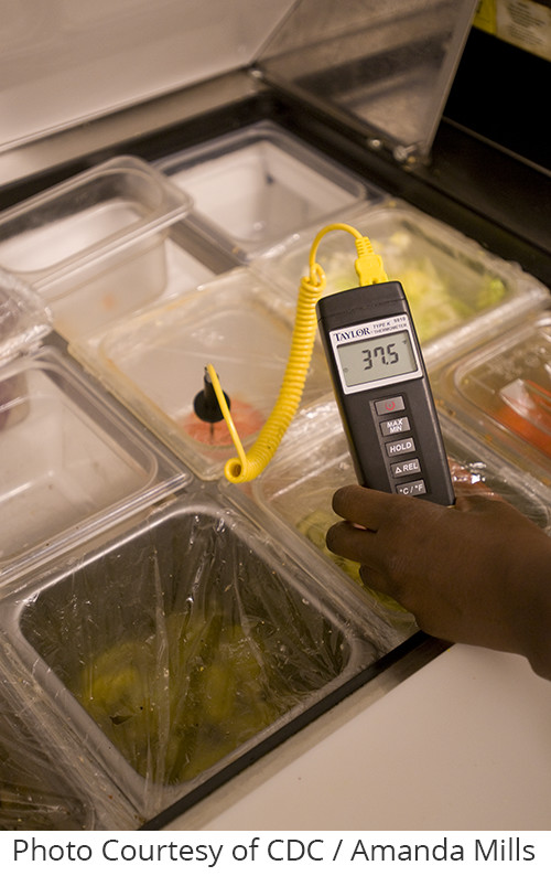 uncover eh: This image depicts the left hand of a state-appointed public health inspector holding an electronic thermometer. The thermosensitive probe had been placed into a cold table container of an unknown food, and had recorded a temperature of 37.5oF, which when converted, equals 3.1oC.