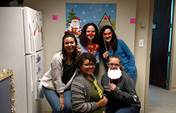NEHA staff having fun at the winter hot cocoa party