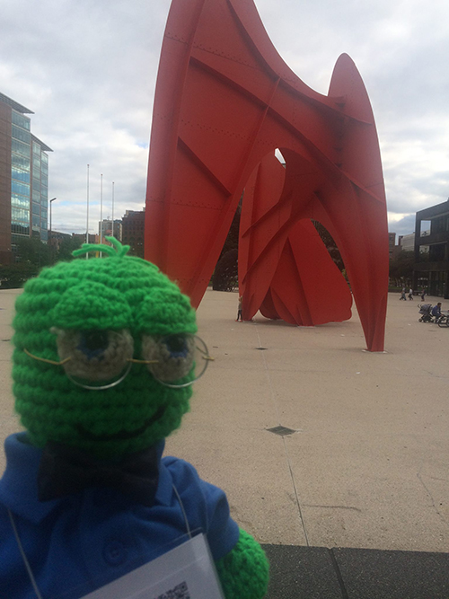 "Lex, the NEHA mascot, visiting the sculpture ""Le Grande Vitesse"" of Alexander Calder"