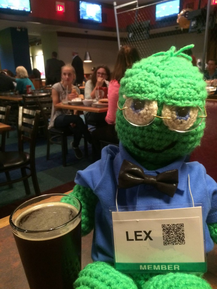 Lex, the NEHA Mascot, enjoying a local brew at the sports bar in Amway