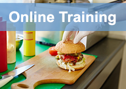 Food Safety Online Training Resources: Food Handler preparing hamburger